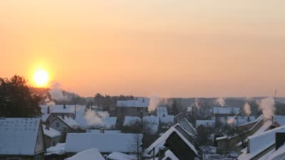 stock-footage-little-town-s-morning-winter-view-the-main-accent-in-the-shot-is-rising-sun-and-rising-up-smoke