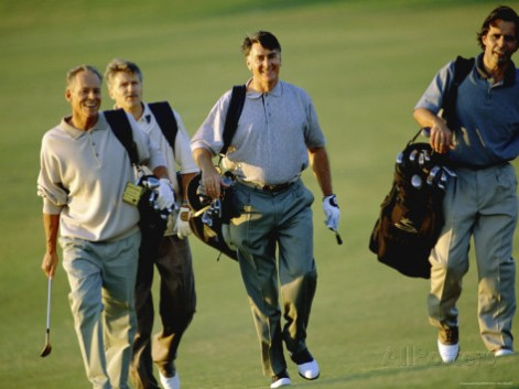 four-men-walking-on-a-golf-course
