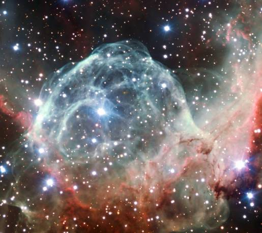 This VLT image of the Thor's Helmet Nebula was taken on the occasion of ESO's 50th Anniversary, 5 October 2012, with the help of Brigitte Bailleul — winner of the Tweet Your Way to the VLT! competition. The observations were broadcast live over the internet from the Paranal Observatory in Chile. This object, also known as NGC 2359, lies in the constellation of Canis Major (The Great Dog). The helmet-shaped nebula is around 15 000 light-years away from Earth and is over 30 light-years across. The helmet is a cosmic bubble, blown as the wind from the bright, massive star near the bubble's centre sweeps through the surrounding molecular cloud.
