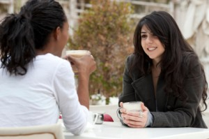 Two-women-talking-in-a-cafe-300x199