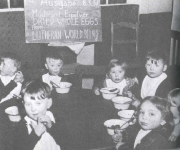 Picture of German Children receiving aid from LWR in 1951, taken from Together in Hope book by John Bachman.